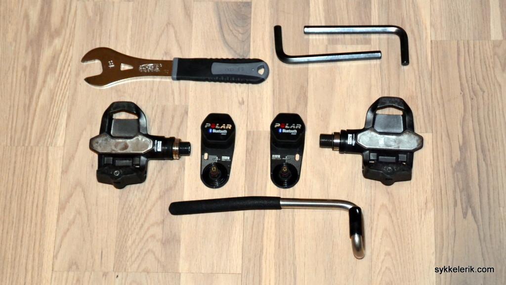 Dette er hva som følger med i esken når man kjøper Polar Look Kéo Power: Pedaler inkludert sendere, samt diverse verktøy. I tillegg finnes det også strips og andre småting av plastikk og gummi.